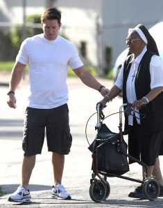 Actor Mark Wahlberg helps an elderly nun cross the street in Miami