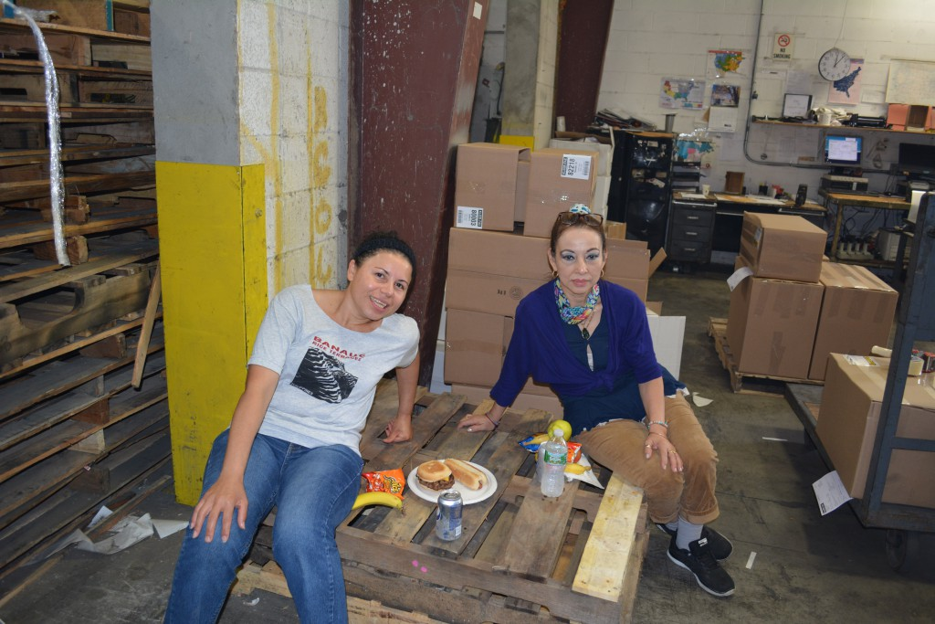Machine operators, Lillian (15 years) and Leticia (25 years) kick back and relax